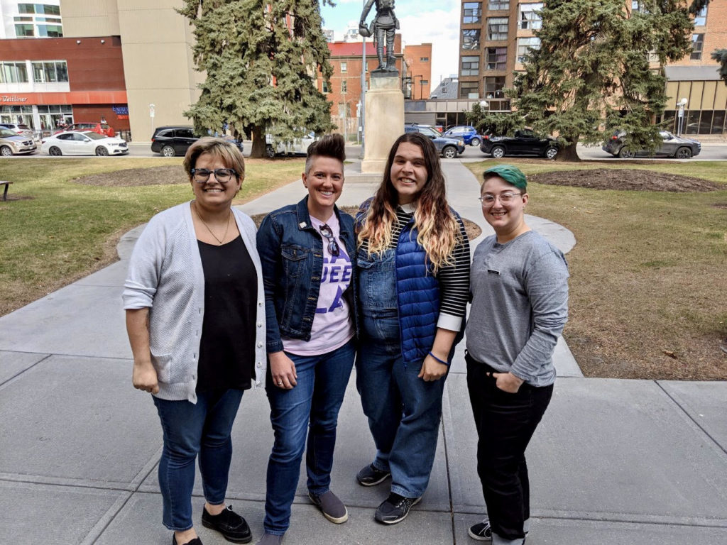 Calgary Queer Church, Affirming Connections, Skipping Stone Foundation, and the Calgary Public Library helped to bring cartoonist Sophie Labelle to the Memorial Park Library on April 20 for a wonderful community building event! L-R Kiran Stewart-McKee of CQC, Pam Rocker of Affirming Connections, Sophie Labelle, and Sam Bruce of Skipping Stone Foundation.